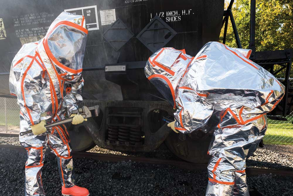 First responders in Frontline 500 Chemical/FR protection suits work to stop a chemical leak on a tanker car