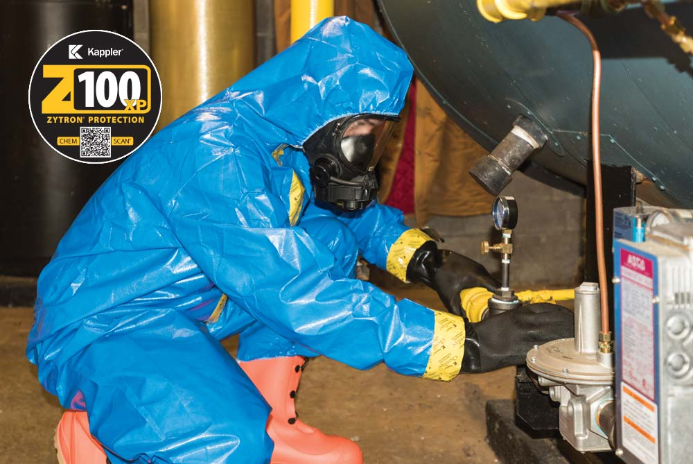 Worker in Zytron 100XP suit working in a building maintenance room where chemicals are present