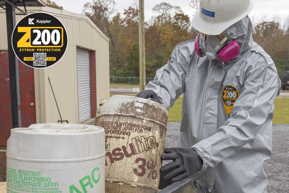 Worker in Zytron 200 protective suit disposing of hazardous chemicals and containers