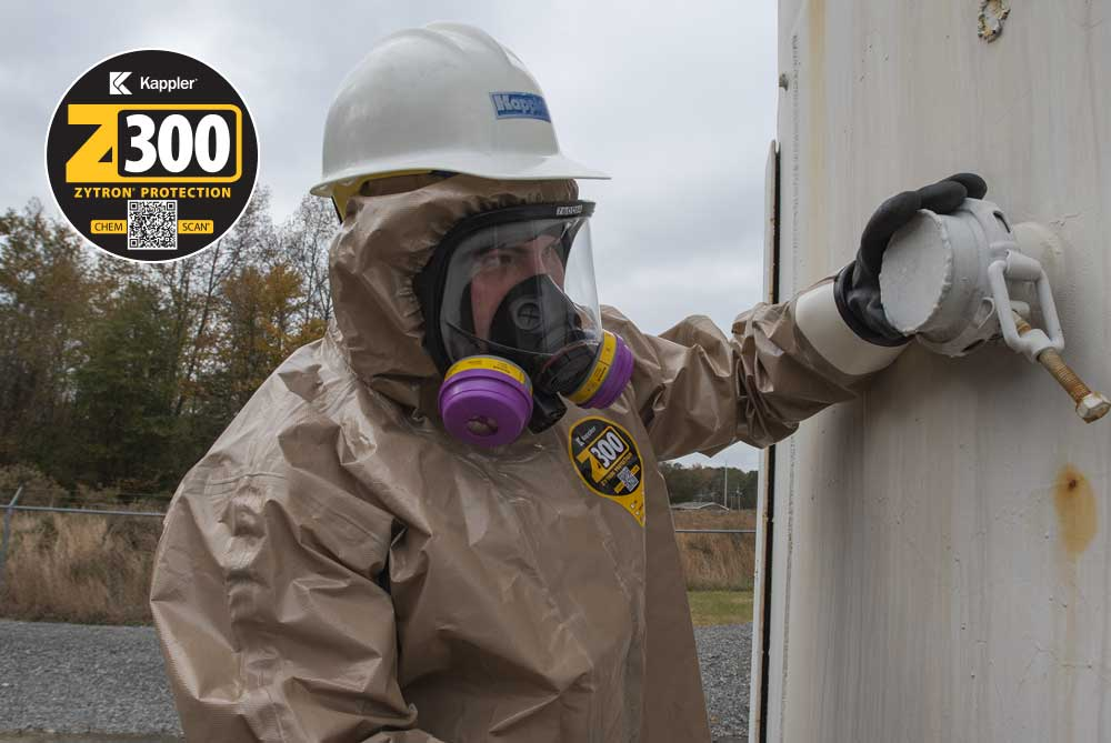 Worker in Zytron 300 protective suit inspects chemical containers and pipes for chemical or gas leaks
