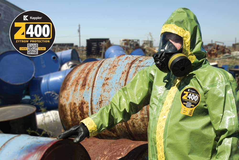 Worker in Zytron 400 suit cleans up hazardous chemicals that were not disposed of properly